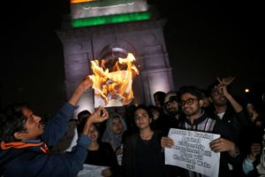 Demonstrators burn a copy of India's Citizenship Amendment Bill during a protest in New Delhi REUTERS