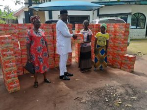 Engr. Francis Njoku assisting women in the rural area with palliatives